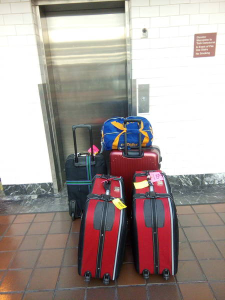 dragging luggage to the rental car