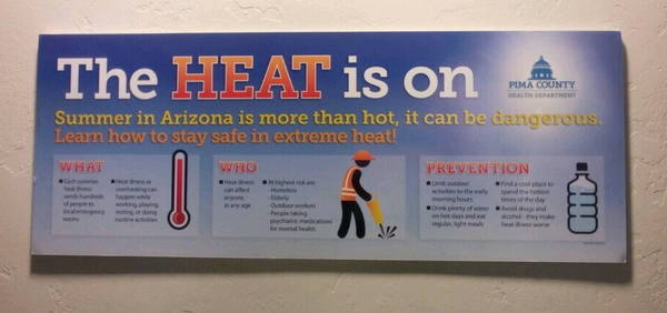 """the heat is on"" sign in Joel D Valdez Main Library"