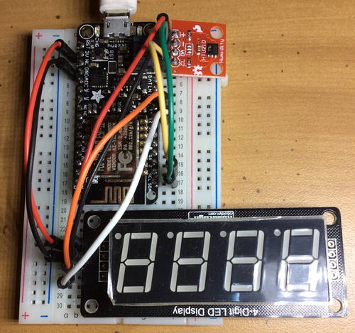 Adafruit HUZZAH Feather, HTU21D breakout, and 4-digit LED display on a half-size breadboard