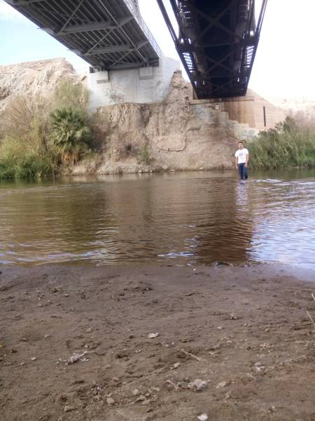 wading in Colorado River at Gateway Park