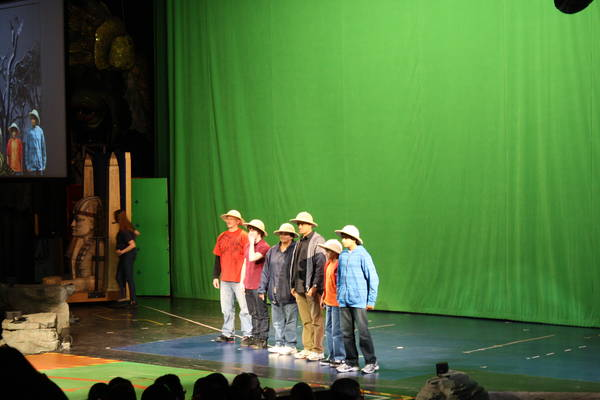 six audience members standing in front of a green curtain, 2011-12-24
